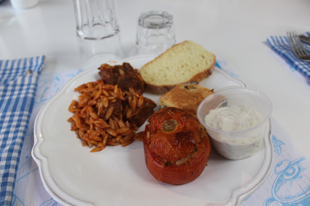 Lunch plate - braised beef and orzo, spinach pie, tzatziki, stuffed tomato, bread and wine