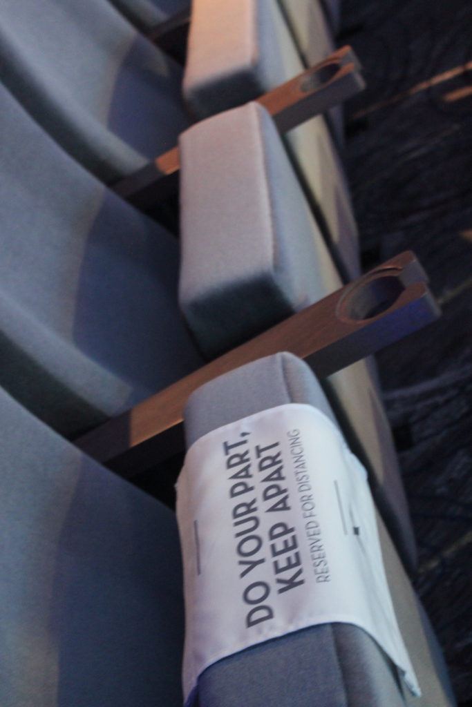 Seats are blocked in the ship's theater to maintain social distancing
