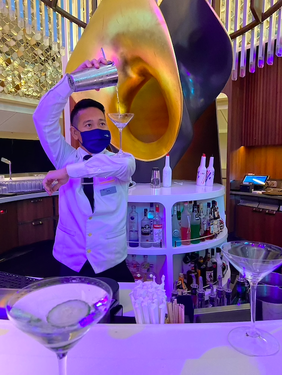 A bartender on the Celebrity Apex - all crew are masked at all times during the cruise