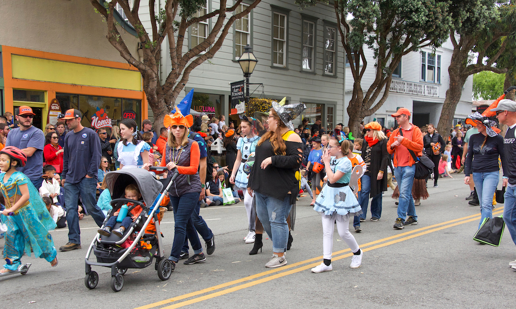 Half Moon Bay, CA - Oct 19, 2019: Unidentified participants in the 49th annual Art and Pumpkin Festival Parade down Main Street in the World Pumpkin Capitol of Half Moon Bay.